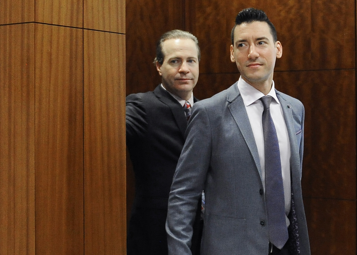 In this April 29, 2016 file photo, David Robert Daleiden, right, leaves a courtroom after a hearing in Houston.  (AP Photo/Pat Sullivan, File)