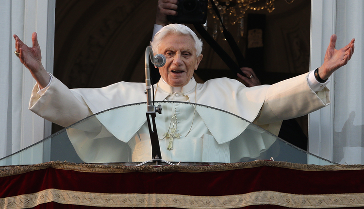 In this Thursday, Feb. 28, 2013 file photo, Pope Benedict XVI greets the crowd from the window of the Pope's summer residence of Castel Gandolfo, the scenic town where he will spend his first post-Vatican days and make his last public blessing as pope. (AP Photo/Andrew Medichini, File)