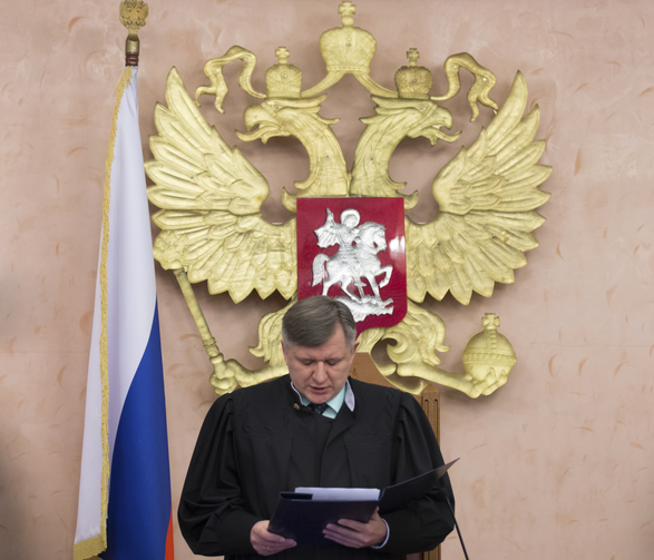 Russia's Supreme Court judge Yuri Ivanenko reads the decision in a court room in Moscow, Russia, on Thursday, April 20, 2017. (AP Photo/Ivan Sekretarev)