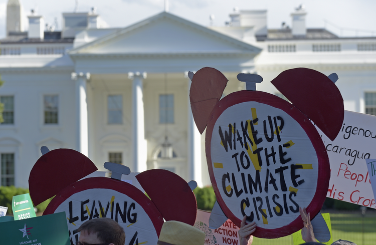 Protesters gather outside the White House in Washington on June 1 to protest President Donald Trump's decision to withdraw the Unites States from the Paris climate change accord. (AP Photo/Susan Walsh)