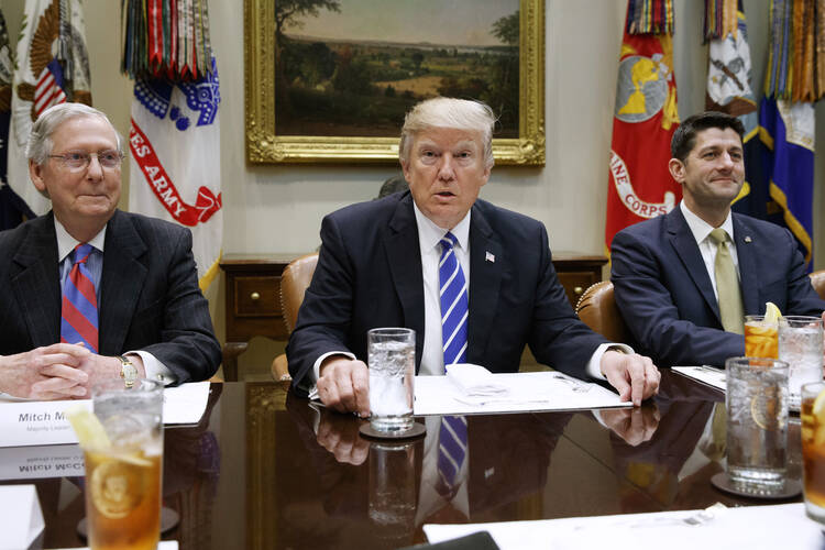President Donald Trump, flanked by Senate Majority Leader Mitch McConnell of Ky. and House Speaker Paul Ryan of Wis., hosts a meeting with House and Senate leadership, Wednesday, March 1, 2017, in the Roosevelt Room of the White House in Washington. (AP Photo/Evan Vucci)