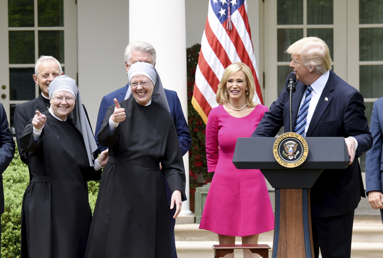 U.S President Donald Trump with members of the Little Sisters of the Poor in the White House rose garden on May 4 (Photo by Olivier Douliery/ Abaca (Sipa via AP Images)