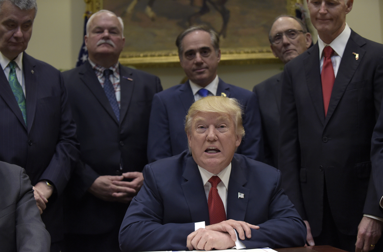 President Donald Trump talks about the Veterans Choice Program Extension and Improvement Act before signing it, Wednesday, April 19, 2017, in the Roosevelt Room of the White House in Washington. (AP Photo/Susan Walsh)