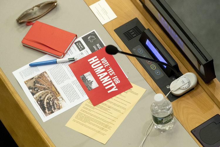Leaflets are seen on a delegates desk before a vote by the conference to adopt a legally binding instrument to prohibit nuclear weapons, leading towards their total elimination, Friday, July 7, 2017 at United Nations headquarters. (AP Photo/Mary Altaffer)