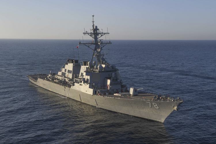 In this image provided by the U.S. Navy, the guided-missile destroyer USS Porter (DDG 78) transits the Mediterranean Sea on March 9, 2017. The United States fired a barrage of cruise missiles into Syria Thursday night in retaliation for this week's gruesome chemical weapons attack against civilians, the first direct American assault on the Syrian government and Donald Trump's most dramatic military order since becoming president.  (Mass Communication Specialist 3rd Class Ford Williams/U.S. Navy via AP)