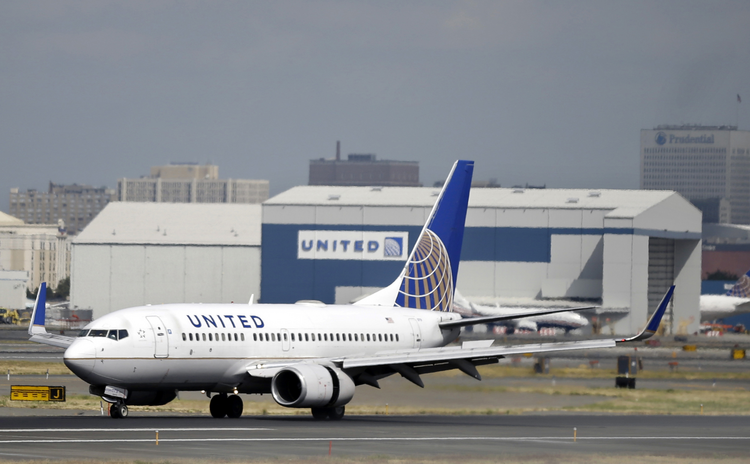In this Sept. 8, 2015, file photo, a United Airlines passenger plane lands at Newark Liberty International Airport in Newark, N.J. Twitter users are poking fun at United's tactics in having a man removed from an overbooked Chicago to Louisville flight on April 9, 2017. (AP Photo/Mel Evans, File)