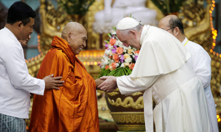 Pope Francis greets Bhaddanta Kumarabhivasma, chairman of the supreme council of Buddhist monks, during a Nov. 29 meeting with monks of the council at the Kaba Aye Pagoda in Yangon, Myanmar. (CNS photo/Max Rossi, Reuters)