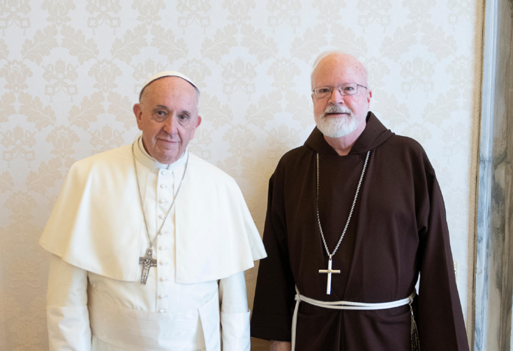 Pope Francis poses for a photo with Cardinal Sean P. O'Malley of Boston, president of the Pontifical Commission for the Protection of Minors, during a private audience at the Vatican April 19. (CNS photo/Vatican Media)