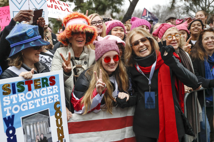 In this Jan. 21, 2017 file photo, Gloria Steinem, center right, greets protesters at the barricades before speaking at the Women's March on Washington during the first full day of Donald Trump's presidency, in Washington. (AP Photo/John Minchillo, File)