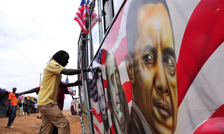 A man boards a matatu minibus adorned with Barack Obama, head of the US president's visit. Photograph: Simon Maina/AFP/Getty Images