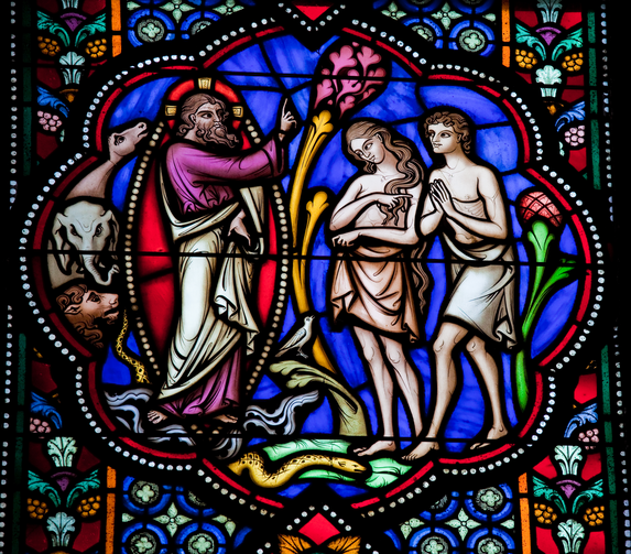 PARENTAL UNITS. Stained glass window depicting Adam and Eve in the cathedral of Brussels, Belgium.