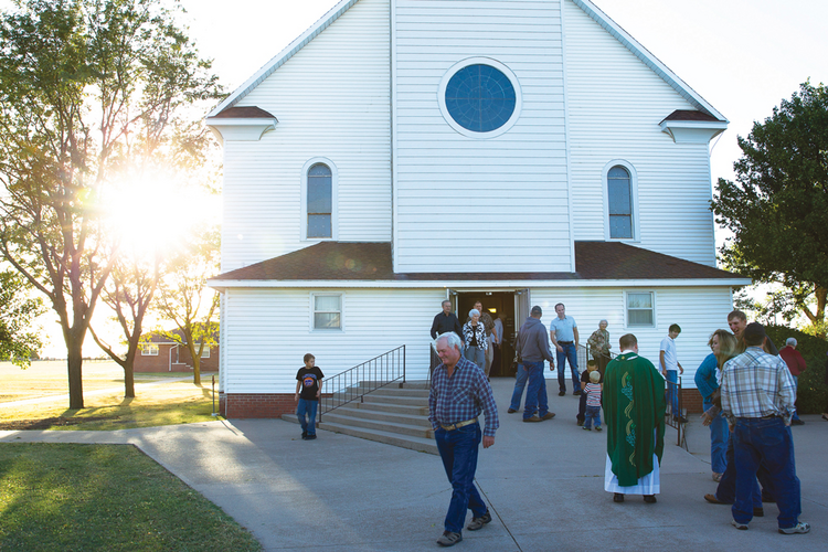 OPEN HOUSE. Churchgoers in St. Leo, Kan., after Saturday evening Mass.