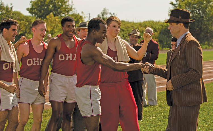 "FOR THE WIN. Stephan James, center, as Jesse Owens and Jason Sudeikis, right, as Larry Snyder in ""Race"""