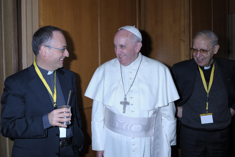 Pope Francis is pictured with Jesuit Father Antonio Spadaro, editor of La Civilta Cattolica, left, and Father Adolfo Nicolas, superior general of the Society of Jesus, during a break at a meeting with the superiors of men's religious orders at the Vatica n Nov. 29. During the meeting, the pope ordered the revision of norms on the relations between religious orders and local bishops. (CNS photo/L'Osservatore Romano) (Jan. 3, 2014)