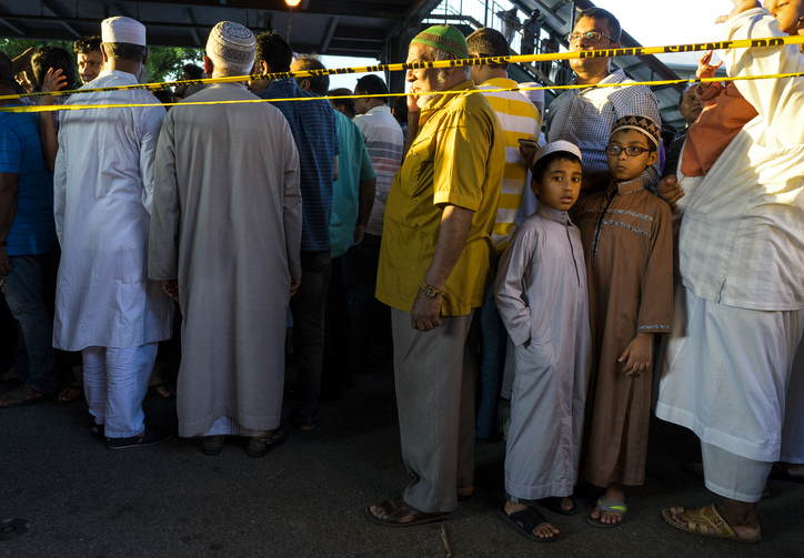 Fear for the Future. People gather for a demonstration on Aug. 13 near a crime scene after the leader of a Queens mosque and an associate were fatally shot as they left afternoon prayers. (AP Photo/Craig Ruttle)