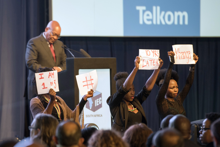 Protesters interrupt South Africa's President Jacob Zuma, as he delivers a speech at the announcement of the results of the municipal elections in Pretoria, South Africa on Aug. 6, 2016. (AP Photo/Herman Verwey)