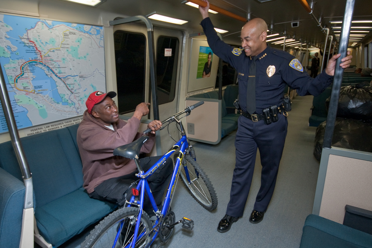 BART Police Chief Kenton Rainey, who leads a department of more than 200 officers, speaks with a passenger. Photo courtesy of BART