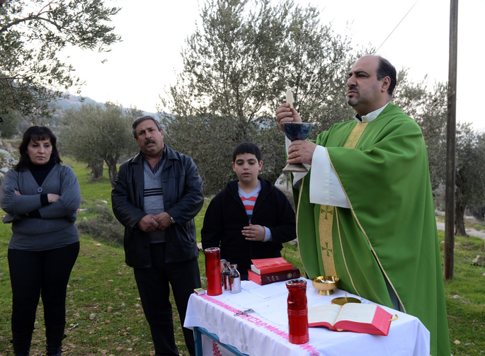 An outdoor Mass near the Salesian monastery in Beit Jalla on Jan. 18.