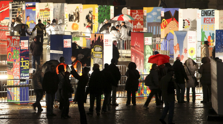 People walk next to colorful giant domino pieces placed along a stretch of the original path of the Berlin Wall Nov. 9, the 20th anniversary of the wall's demise. (CNS photo/Maya Hitij, Reuters)