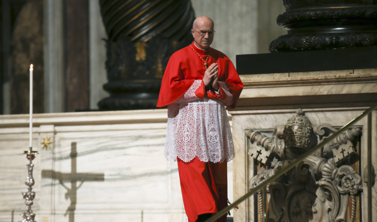 Cardinal Tarcisio Bertone, former Vatican secretary of state, walks during the Good Friday service in St. Peter's Basilica at the Vatican March 25. (CNS photo/Alessandro Bianchi, Reuters)