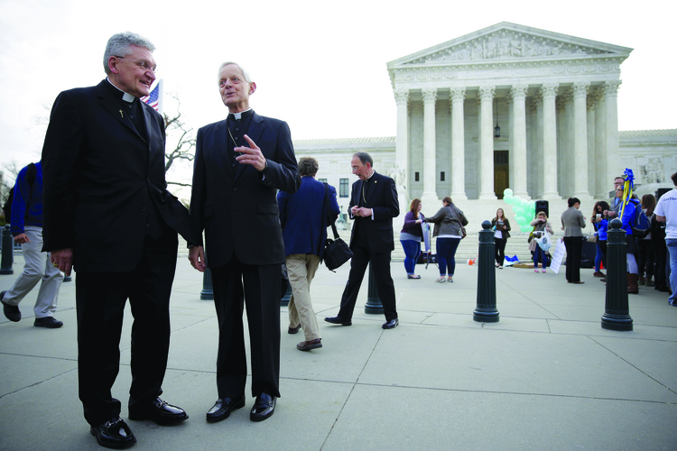 Bishop David A. Zubik of Pittsburgh, left, and Cardinal Donald W. Wuerl of Washington near the U.S. Supreme Court on March 23.