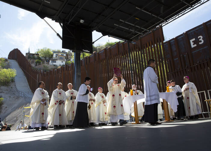 U.S. bishops, led by Cardinal Sean P. O'Malley of Boston, celebrates Mass at the border fence in Nogales, Ariz., in April. (CNS photo/Nancy Wiechec)