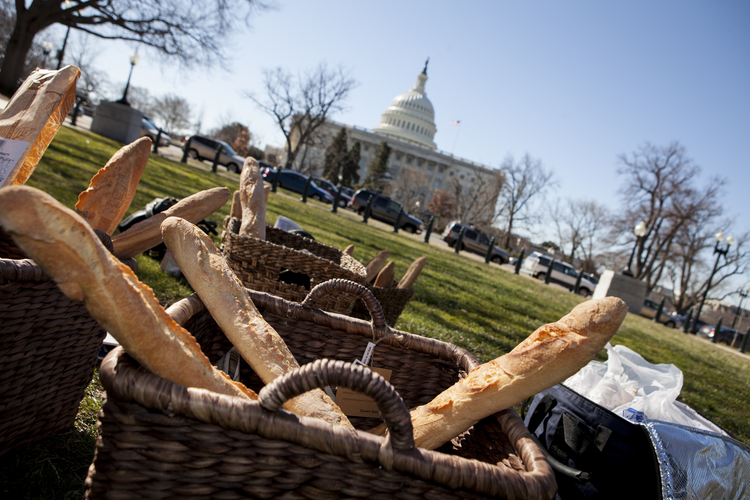 Baskets of bread sit outside U.S. Capitol as faith leaders prepare news conference on budget proposals.