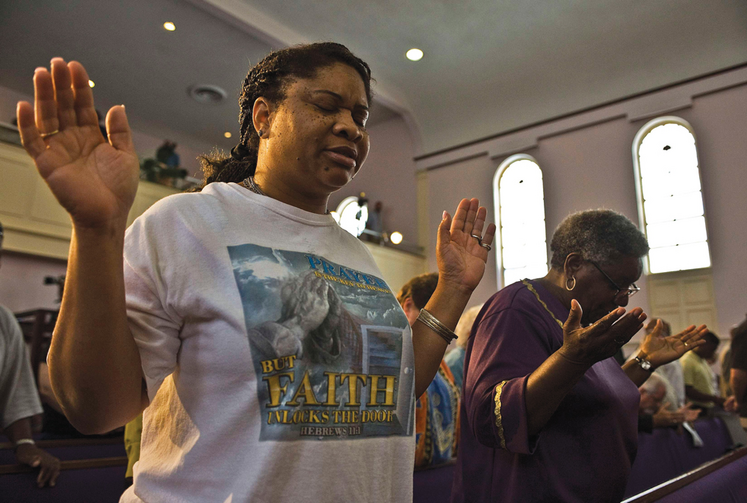 SEE THE VICTIM. Women pray at the New Life Word Center Church in Sanford, Fla., after the George Zimmerman murder trial.