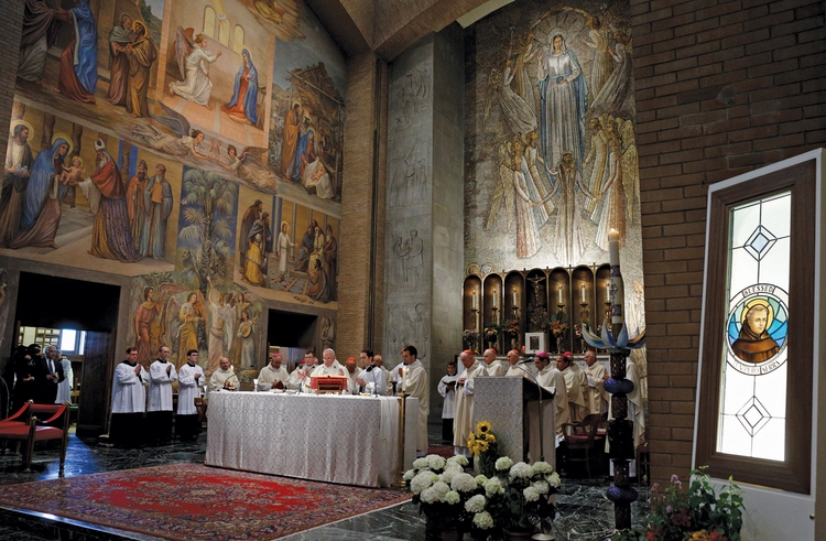 A CONTROVERSIAL CANONIZATION. An image of Blessed Junípero Serra, right, is seen as Pope Francis celebrates Mass in Rome on May 2.