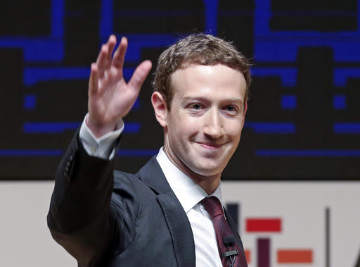 Mark Zuckerberg, chairman and CEO of Facebook, waves at the CEO summit during the annual Asia Pacific Economic Cooperation (APEC) forum in Lima, Peru.