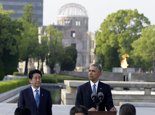 U.S. President Barack Obama delivers remarks, accompanied by Japanese Prime Minister Shinzo Abe at Hiroshima Peace Memorial Park in Hiroshima, western Japan. (AP Photo/Carolyn Kaster)