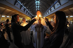 Pictured is th e Easter Vigil service at Our Lady of Lourdes Parish in De Pere, Wisc. (CNS file photo/Sam Lucero, The Compass) (July 5, 2013)
