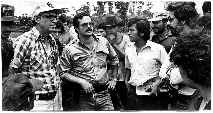 Cardenal, left, with organizers and volunteers for the Sandinista literacy campaign in 1980.