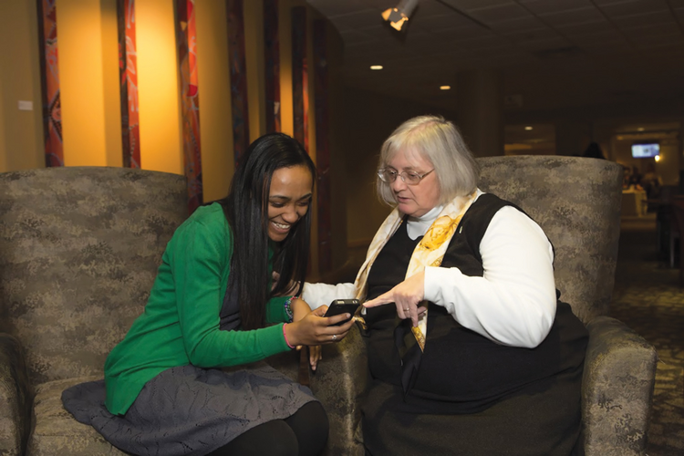 AMONG FRIENDS. Tia Clifford, left, and Linda Lee Jackson, O.P., celebrate National Catholic Sisters Week at St. Catherine University in St. Paul, Minn., in March.