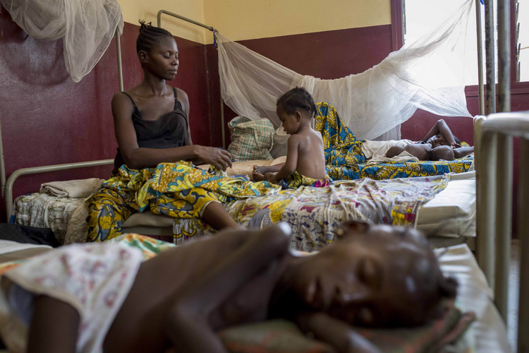 A mother tends to her child, who is suffering from malnutrition, at a pediatrics hospital in Bangui, Central African Republic, on Feb. 25.