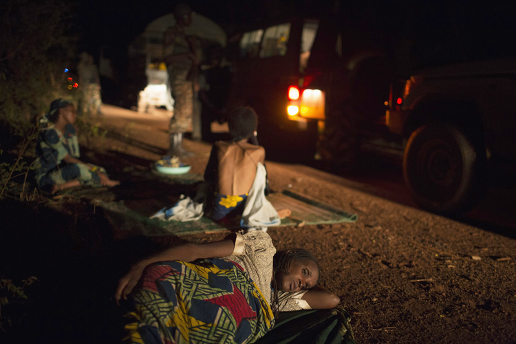 Women rest along the road in April during their journey towards Chad's border escorted by African Union soldiers in Central African Republic.