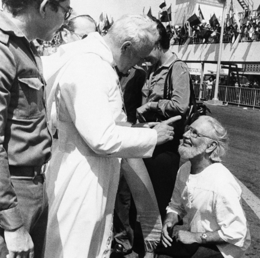 Daniel Ortega flanks Pope John Paul II who wags his finger at culture minister and priest Ernesto Cardenal, during welcoming ceremonies at the airport in Managua, Nicaragua, in March 1983. (AP Photo/Barricada, File)