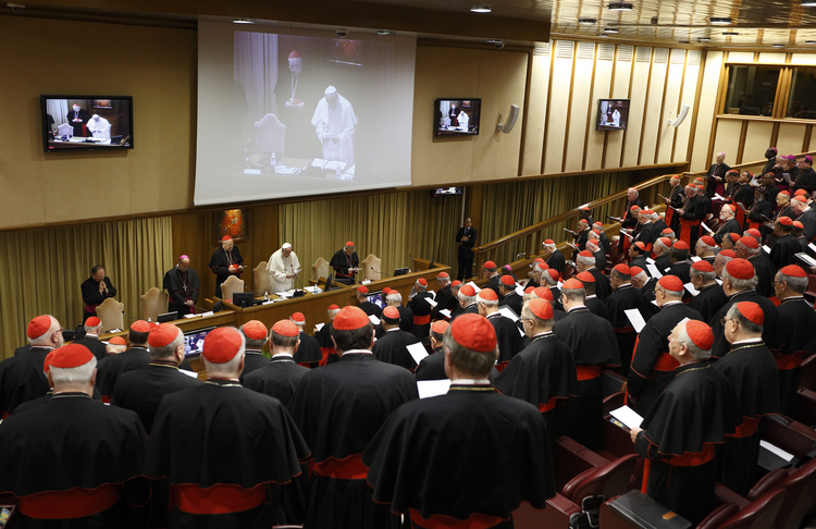 Pope Francis leads opening prayer during a meeting of cardinals in the synod hall at the Vatican Feb. 20.
