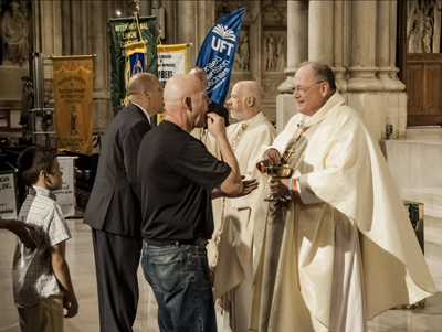 Cardinal Dolan celebrates Labor Mass in 2012