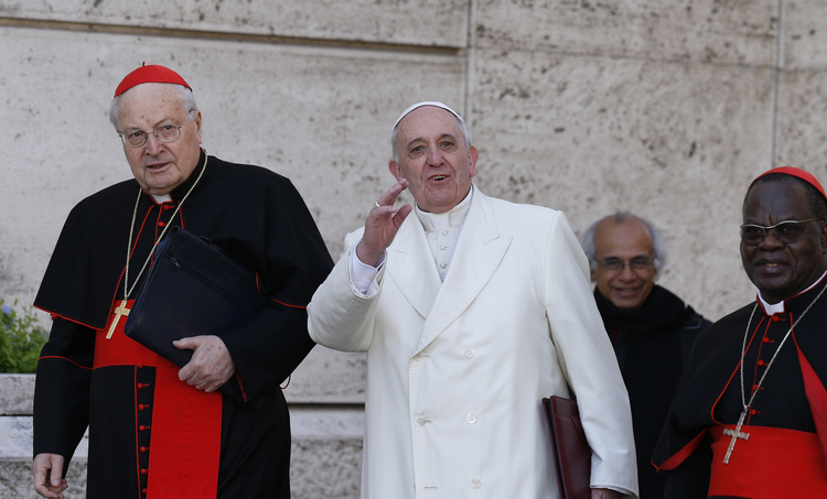 Pope Francis greets the press as he arrives with Cardinals Angelo Sodano and Laurent Monsengwo Pasinya to lead a meeting of cardinals.