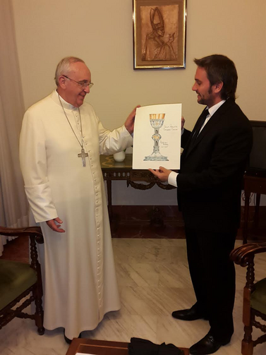 Adrian Pallarols shows Pope Francis the design for the chalice.