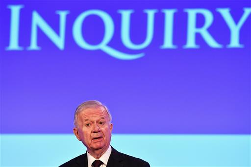 John Chilcot presents the Iraq Inquiry Report at the Queen Elizabeth II Centre in London, Wednesday, July 6, 2016 (Jeff J Mitchell/Pool via AP).