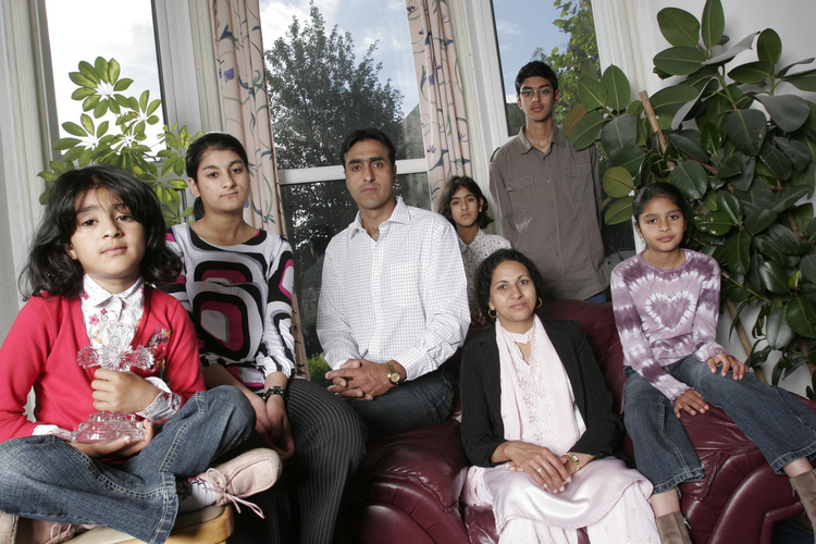 From left to right, Leena, Anniesa, Nissar, Sarah, Kubra, Issar, and Miriam Hussain, a Christian family who have been threatened with death for converting from Islam in West Yorkshire, England. Photo by Rii Schroer, courtesy of Nissar Hussain