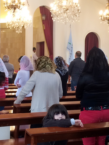 Assyrian Christians attend a service at St. Georges Assyrian Church of the East in Beirut, March 11 (CNS photo/Doreen Abi Raad).