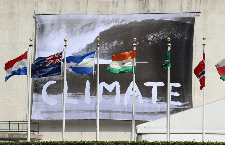 "A ""Climate"" banner is seen hanging from the U.N. General Assembly building in New York City June 30, a day after the U.N. hosted a high-level event on climate change. (CNS photo/Gregory A. Shemitz)"