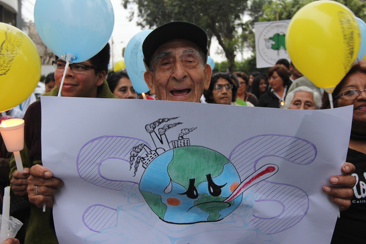 Valerio Mendoza, 83, joins a Nov. 30 vigil for climate change on the eve of the U.N. climate summit in Lima, Peru. (CNS photo/Barbara Fraser)