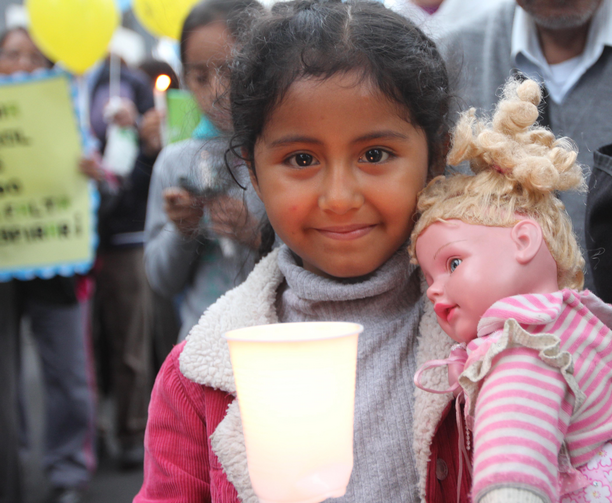 Ruby Arazabel, 6, takes part in a Nov. 30 vigil for climate change on the eve of the U.N. climate summit in Lima, Peru. (CNS photo/Barbara Fraser)