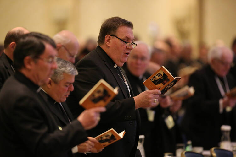 Cardinal-designate Joseph W. Tobin of Indianapolis, center, joins other bishops during morning prayer Nov. 15 at the annual fall general assembly of the U.S. Conference of Catholic Bishops in Baltimore (CNS photo/Bob Roller).