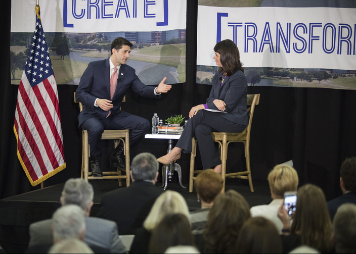 House Speaker Paul Ryan, R-Wis., talks with Heather Reynolds, CEO and president of Catholic Charities Fort Worth, Texas, during a town hall meeting on poverty April 3 at the charity's Fort Worth campus.