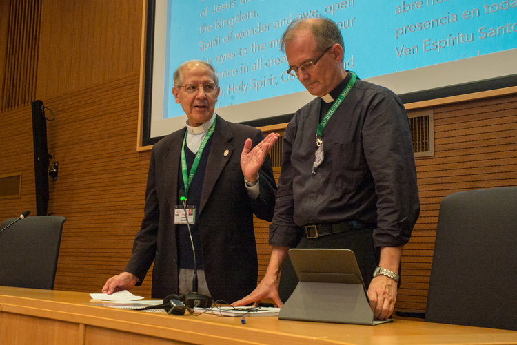 Father Adolfo Nicolas, the outgoing Jesuit superior, hands over the meeting to Jesuit Father Jim Grummer during an Oct. 3 gathering in Rome to elect a new superior general. (CNS photo/Don Doll, S.J.)